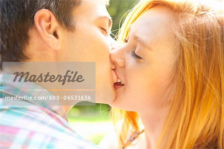 Young Couple Kissing in Park on a Summer Day, Portland, Oregon, USA Stock Photo - Premium Royalty-Free, Image code: 600-06531636