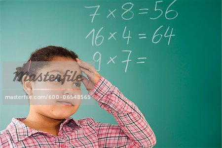 Girl Thinking in Classroom, Baden-Wurttemberg, Germany Stock Photo - Premium Royalty-Free, Image code: 600-06548565