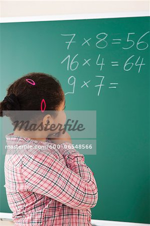 Girl Thinking in Classroom, Baden-Wurttemberg, Germany Stock Photo - Premium Royalty-Free, Image code: 600-06548566