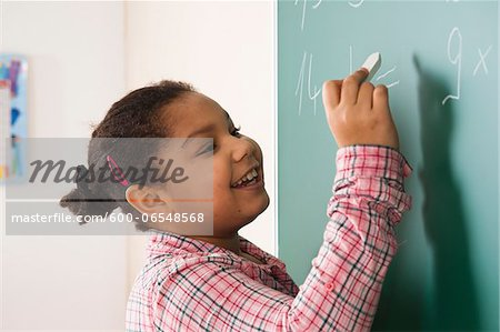 Girl Answering Question at Blackboard in Classroom, Baden-Wurttemberg, Germany Stock Photo - Premium Royalty-Free, Image code: 600-06548568