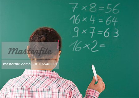 Girl Answering Question at Blackboard in Classroom, Baden-Wurttemberg, Germany Stock Photo - Premium Royalty-Free, Image code: 600-06548569