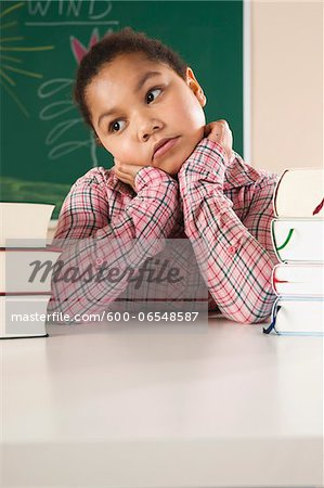 Girl and Textbooks in Classroom, Baden-Wurttemberg, Germany Stock Photo - Premium Royalty-Free, Image code: 600-06548587
