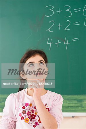 Girl Answering Question at Blackboard in Classroom, Baden-Wurttemberg, Germany Stock Photo - Premium Royalty-Free, Image code: 600-06548613