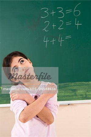 Girl Answering Question at Blackboard in Classroom, Baden-Wurttemberg, Germany Stock Photo - Premium Royalty-Free, Image code: 600-06548614