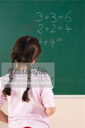 Girl Answering Question at Blackboard in Classroom, Baden-Wurttemberg, Germany Stock Photo - Premium Royalty-Free, Image code: 600-06548615