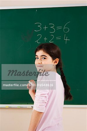 Girl Answering Question at Blackboard in Classroom, Baden-Wurttemberg, Germany Stock Photo - Premium Royalty-Free, Image code: 600-06548616