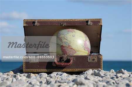 Globe in Suitcase on Rocky Beach, Frontignan, Herault, France Stock Photo - Premium Royalty-Free, Image code: 600-06553503