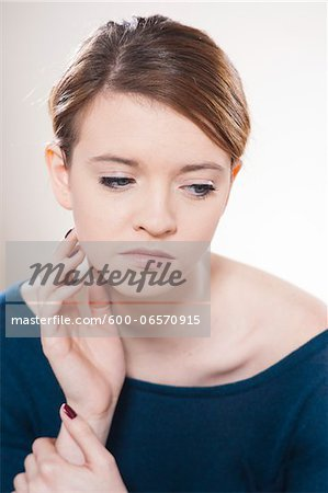 Head and Shoulders Portrait of Teenage Girl in Studio Stock Photo - Premium Royalty-Free, Image code: 600-06570915