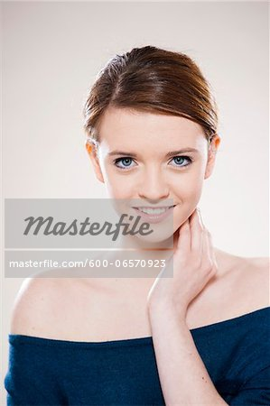 Head and Shoulders Portrait of Teenage Girl in Studio Stock Photo - Premium Royalty-Free, Image code: 600-06570923