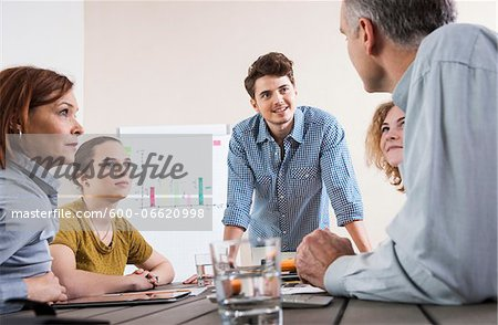 Business People Working and Meeting in Office Stock Photo - Premium Royalty-Free, Image code: 600-06620998