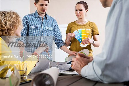 Business People in Meeting Looking at Plans and Color Swatches Stock Photo - Premium Royalty-Free, Image code: 600-06621010