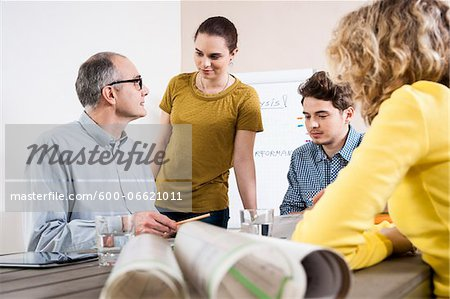 Business People in Meeting Looking at Plans Stock Photo - Premium Royalty-Free, Image code: 600-06621011
