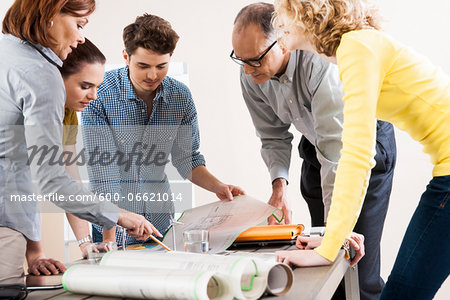 Business People in Meeting Looking at Plans and Model of Windmill Stock Photo - Premium Royalty-Free, Image code: 600-06621014