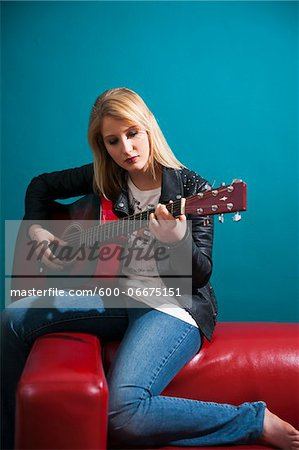 Woman Playing Acoustic Guitar Stock Photo - Premium Royalty-Free, Image code: 600-06675151