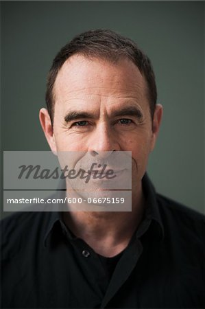 Head and Shoulders Portrait of Mature Man Stock Photo - Premium Royalty-Free, Image code: 600-06675159