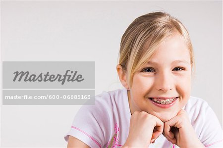 Portrait of Girl with Braces in Studio Stock Photo - Premium Royalty-Free, Image code: 600-06685163