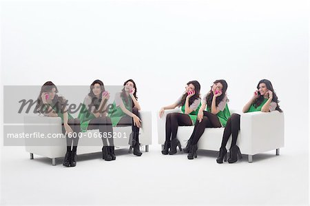 Multiple Image of Young Woman Sitting on Sofa in a Variety of Positions, using Smart Phone, Studio Shot on White Background Stock Photo - Premium Royalty-Free, Image code: 600-06685201