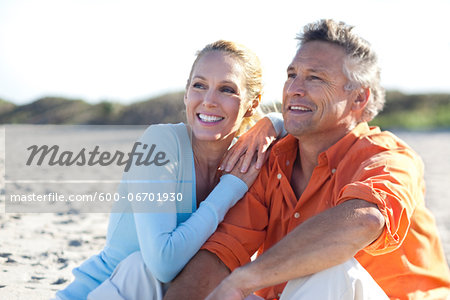 Mature Couple Sitting on Beach, Jupiter, Palm Beach County, Florida, USA Stock Photo - Premium Royalty-Free, Image code: 600-06701930