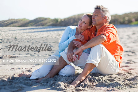 Mature Couple Sitting on Beach, Jupiter, Palm Beach County, Florida, USA Stock Photo - Premium Royalty-Free, Image code: 600-06701932