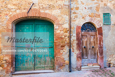 Old Wooden Doors of House in Alley, Pienza, Val d'Orcia, Tuscany, Italy Stock Photo - Premium Royalty-Free, Image code: 600-06702040