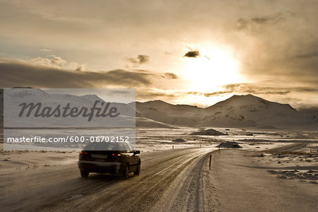 Car driving on snowy road in Iceland Stock Photo - Premium Royalty-Free, Image code: 600-06702152
