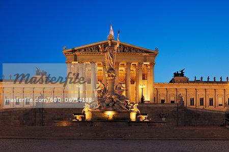 Austrian Parliament and Pallas Athene statue in Vienna illuminated at dusk. Vienna, Austria.
