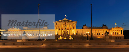 Austrian Parliament and Pallas Athene statue in Vienna illuminated at dusk. Vienna, Austria. Stock Photo - Premium Royalty-Free, Image code: 600-06714189