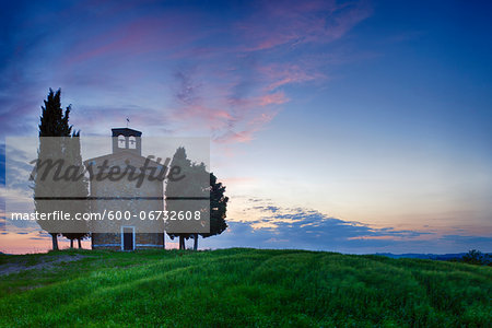 Chapel of Vitaleta with Cypress Trees at dusk after sunset. Chapel of Vitaleta, Val d'Orcia, Siena Province, Tuscany, Italy.