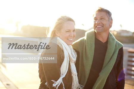 Mature Couple Walking along Pier, Jupiter, Palm Beach County, Florida, USA Stock Photo - Premium Royalty-Free, Image code: 600-06732644