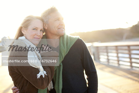 Mature Couple Walking along Pier, Jupiter, Palm Beach County, Florida, USA Stock Photo - Premium Royalty-Free, Image code: 600-06732646