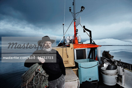 Fisherman with gray beard on his boat on a winter day, Iceland Stock Photo - Premium Royalty-Free, Image code: 600-06732723