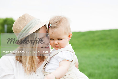 Portrait of Mother and Daughter Outdoors, Mannheim, Baden-Wurttemberg, Germany Stock Photo - Premium Royalty-Free, Image code: 600-06752390