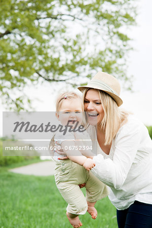 Portrait of Mother and Daughter Outdoors, Mannheim, Baden-Wurttemberg, Germany Stock Photo - Premium Royalty-Free, Image code: 600-06752394