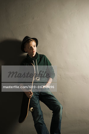 Portrait of Boy with Skateboard, Studio Shot Stock Photo - Premium Royalty-Free, Image code: 600-06752496