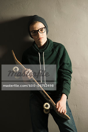 Portrait of Boy with Skateboard, Studio Shot Stock Photo - Premium Royalty-Free, Image code: 600-06752498
