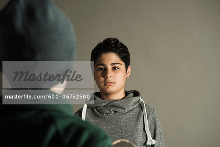 Teenage Boy looking at Boy, Studio Shot Stock Photo - Premium Royalty-Free, Image code: 600-06752500