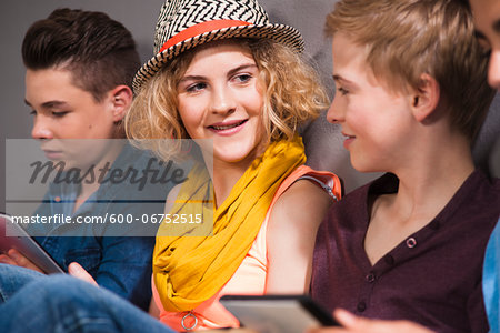 Teenagers with Tablet PC, Studio Shot Stock Photo - Premium Royalty-Free, Image code: 600-06752515