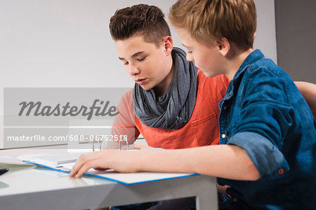Teenage Boys Studying Together, Studio Shot Stock Photo - Premium Royalty-Free, Image code: 600-06752518