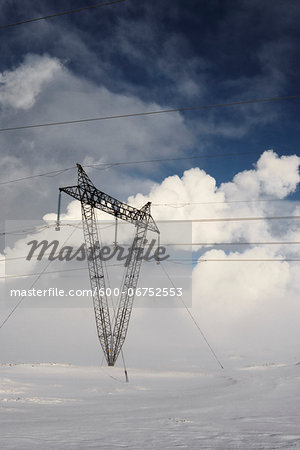 Power Lines in Winter Landscape with Steam from nearby Geothermal Power Plant in Background, Hellisheidi, Iceland Stock Photo - Premium Royalty-Free, Image code: 600-06752553