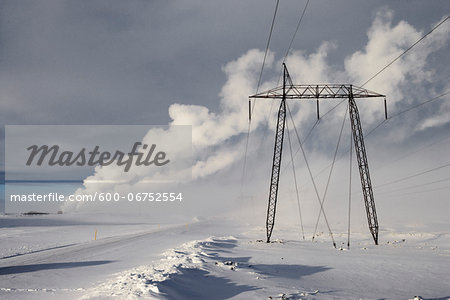 Power Lines in Winter Landscape with Steam from nearby Geothermal Power Plant in Background, Hellisheidi, Iceland Stock Photo - Premium Royalty-Free, Image code: 600-06752554
