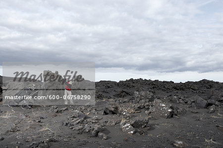 Man Playing Golf in Lava Field, Reykjanes, Iceland Stock Photo - Premium Royalty-Free, Image code: 600-06758290