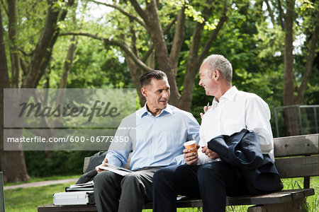 Businessmen Talking on Park Bench, Mannheim, Baden-Wurttemberg, Germany Stock Photo - Premium Royalty-Free, Image code: 600-06773350