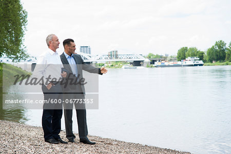 Businessmen Standing by River, Mannheim, Baden-Wurttemberg, Germany Stock Photo - Premium Royalty-Free, Image code: 600-06773353