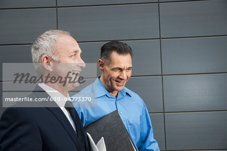 Businessmen Walking and Talking Outdoors, Mannheim, Baden-Wurttemberg, Germany Stock Photo - Premium Royalty-Free, Image code: 600-06773370