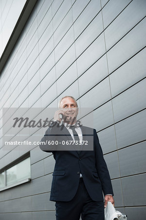 Businessman using Cell Phone Outdoors, Mannheim, Baden-Wurttemberg, Germany Stock Photo - Premium Royalty-Free, Image code: 600-06773372