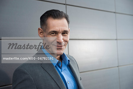 Portrait of businessman standing in front of building, Mannheim, Germany Stock Photo - Premium Royalty-Free, Image code: 600-06782191
