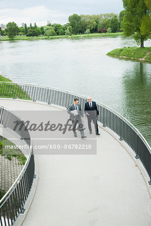 Mature businessmen on walkway talking, Mannheim, Germany Stock Photo - Premium Royalty-Free, Image code: 600-06782210