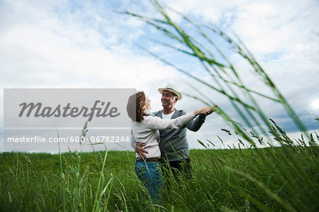 Mature couple dancing in field of grass, Germany Stock Photo - Premium Royalty-Free, Image code: 600-06782244