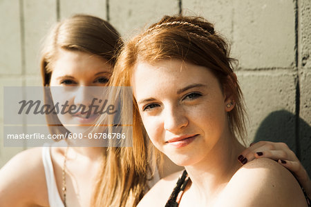 Close-up portrait of young women outdoors Stock Photo - Premium Royalty-Free, Image code: 600-06786786