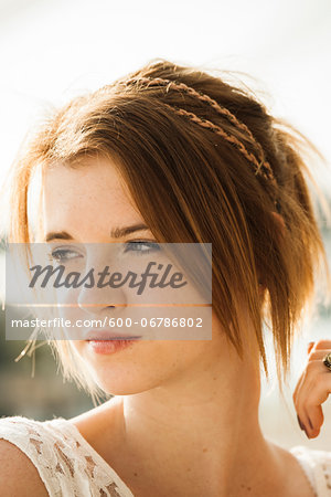 Close-up portrait of teenage girl outdoors, looking to the side Stock Photo - Premium Royalty-Free, Image code: 600-06786802